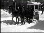 B/W Man riding hourse cart on street of city in winter, Ottawa, Canada / AUDIO