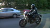 WS TS Man riding motorbike on motorway / London, UK