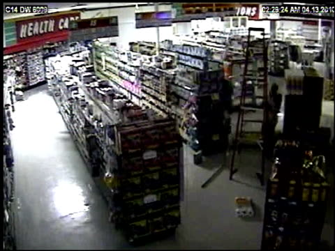 / man robbing drugstore tries to get out through the ceiling and keeps falling off tall ladder Burglar blooper on April 13 2010 in Tulsa Oklahoma