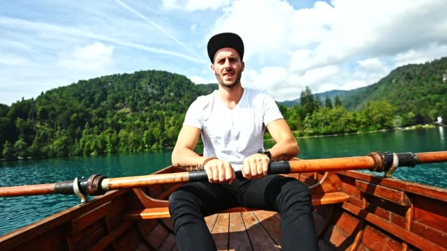 man rowing in bled lake - slovenia