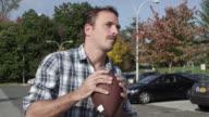Man running around and tossing a football around