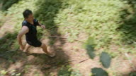 PAN Man running barefoot in the forest