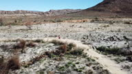 Man running in the barren landscape of the Cederberg Mountains