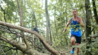 TU Man running in the forest undergrowth
