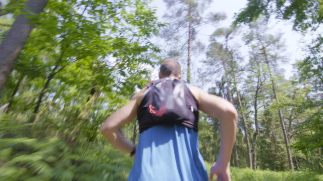 TS Man running on a forest trail
