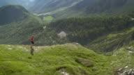 Man running on the mountain road.