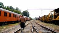 Man running on the railroad