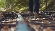 Man Running on train tracks away from Camera 4k Slow Motion