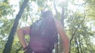 TS Man running through forest in sunshine