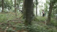 AERIAL Man running through the forest