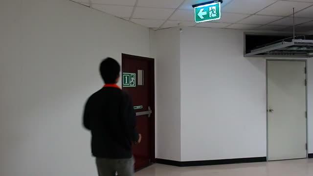 Man running to emergency exit door