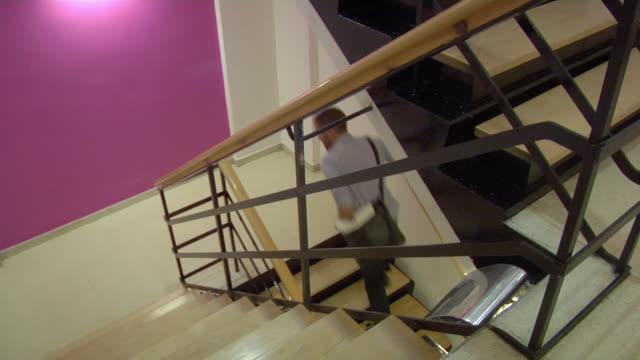 WS Man running upstairs / London, UK