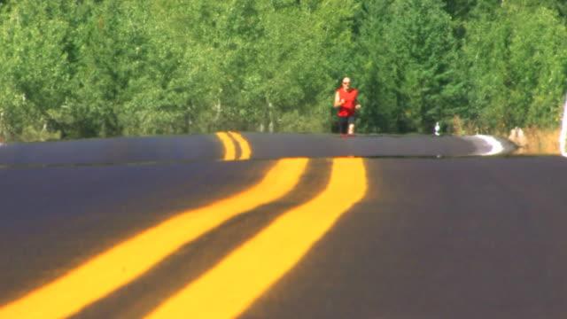 Man runs on road