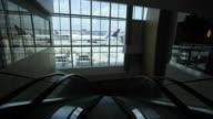 A man runs up an escalator in the International Terminal at Hartsfield Jackson International Airport in Atlanta GA