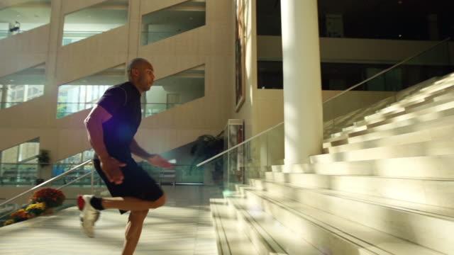 Man runs up stairs