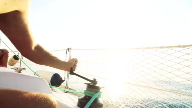 Man sailing during summer holidays