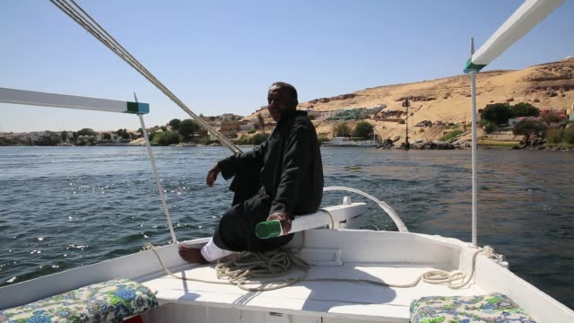 Man sailing on the Nile River in Aswan