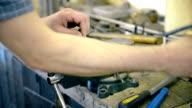 Man sawing metal