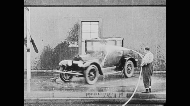 Fatty Arbuckle scrambles to wash a customers car while Buster Keaton and a fellow employee stall the customer by performing amateur gymnastics