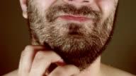 man scratching beard