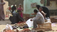 MS ZO Man selling vegetable in village market / Egypt