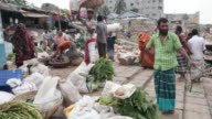 Man selling vegetables at the vegetable market on Buriganga river bank, not far from the Sadarghat Boat Terminal, Dhaka, Bangladesh, Indian Sub-Continent, Asia