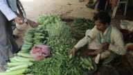 MS Man selling vegetables in market / India