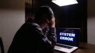 Man serious with Computer System Error