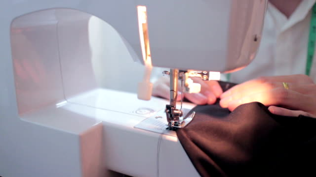 man sewing machine