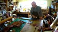 Man sharpening knife in workshop