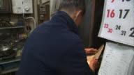 MS Man sharpening knife, Tokyo, Japan