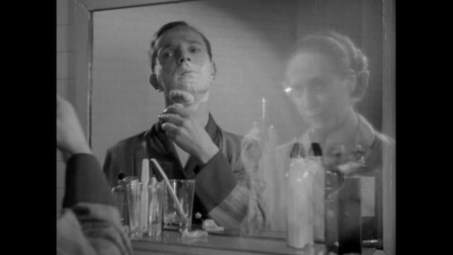 MS Man shaving, and telephone operator appearing beside him in the mirror and telling him to answer the phone before fading away / United Kingdom
