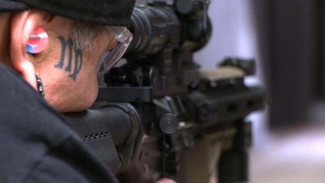 Man Shoots Gun at Gun Range on October 01 2013 in San Diego California