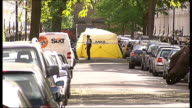 Man shot dead in Shepherd's Bush ENGLAND London Shepherd's Bush Lakeside Road EXT Various of cordonedoff street with forensic tent in distance Police...