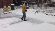 WS ZI Man shoveling snow from sidewalk / Chicago, Illinois, USA