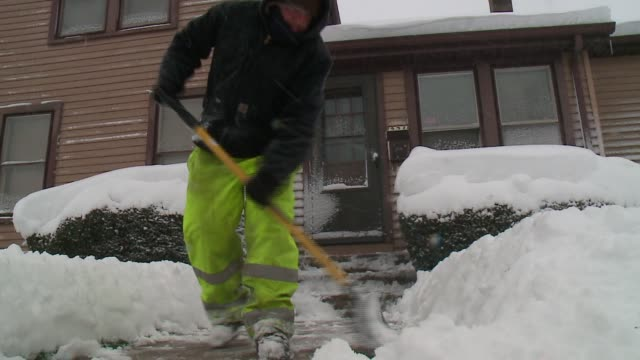 WGN Man Shovels Snow Off Sidewalk in Woodstock Illinois on November 21 2015