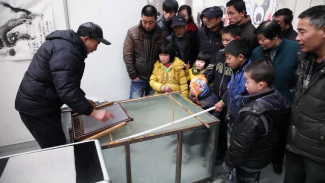 MS TS Man showing Chinese ancient papermaking technology / xi'an, shaanxi, china