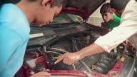 MS Man shows two boys (9-12) car engine, Panama City, Panama