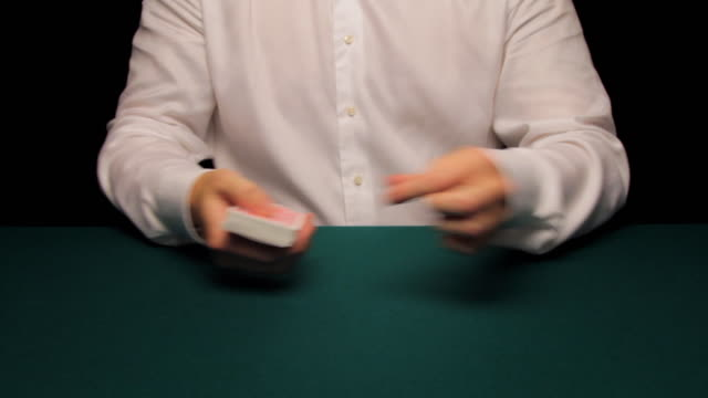 MS man shuffling and cutting deck then producing four aces
