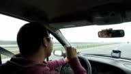 Man singing in a car