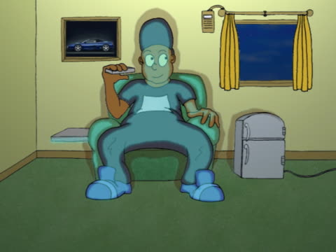Man Sitting in An Armchair in An Automated Living Room Using His Remote Control