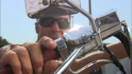LA, CU, ZI, Man sitting on motorcycle holding  hands on handle bars, Jacksonville, Florida, USA