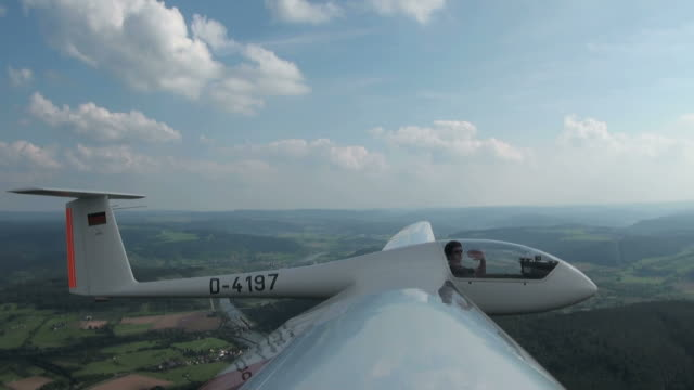 WS POV TU TD Man sitting on sailplane in air / Konz-Koenen, Saar-Valley, Rhineland-Palatinate, Germany