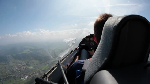 MS POV Man sitting on sailplane in air / Konz-Koenen, Saar-Valley, Rhineland-Palatinate, Germany