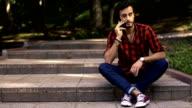 Man sitting on steps in park