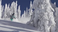 A man skiing down a snow-covered mountain in the winter. - Slow Motion - 1920x1080 - filmed at 240 fps