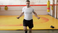 Man skipping rope in slow motion