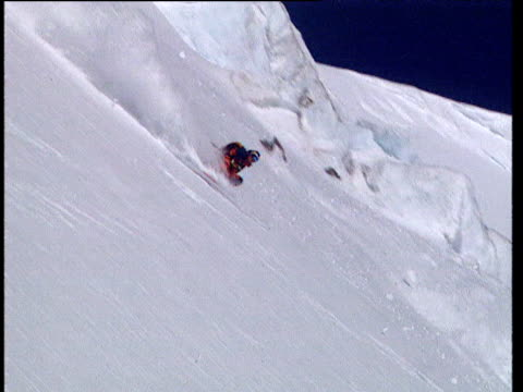 Man skis freestyle down very steep mountain Moscow