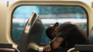 MS Man sleeping in train / Chicago, Illinois, United State