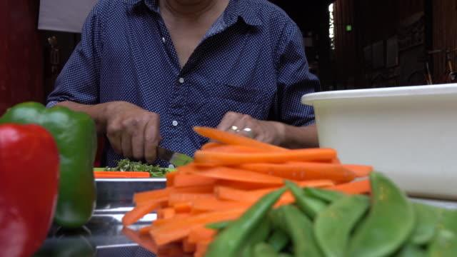 Man slicing carrots